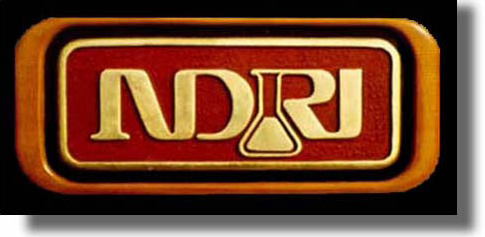 NDRI carved wood sign by Fred Schlatter
